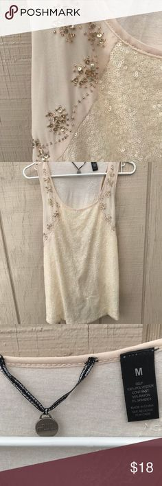 BKE boutique beaded sequin tank tieback medium BKE boutique brand tank. Beautiful beading  and sequin. Knot tie in the back, but you could undo it and steam iron to keep it straight. Cream/ivory color. Great condition.  Size medium, 17 inches across chest, 26 inches top of shoulder to hem.   Self 100 % polyester, contrast 95 % rayon, 5 % spandex. BKE Tops Tank Tops