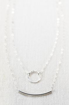 Kameli - (Kaa-MEH- lee) - honey.  Delicate sterling silver double strand necklace featuring a hand forged, hammered eternity circle and modern minimal tube bar. Beautiful sterling silver strand necklace perfect for everyday.  Handmade in Maui, Hawaii.  ✦ DETAILS ✦ ✧ Sterling silver tube. ✧ Sterling silver circle link - handforged and hammered. ✧ Sterling silver cable chain. ✧ Sterling silver spring clasp. ✧ This necklace arrives in a tiny corked glass bottle wrapped in a hand stamped muslin…