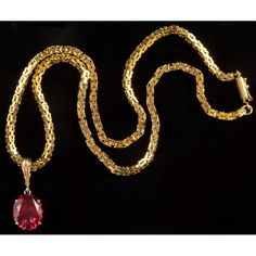 Pink Tourmaline Pendant and Gold Necklace Sold $2,200.