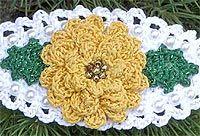Crochet a flower with sparkling Kreinik threads; free pattern