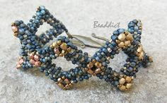 Diamond shape bracelet. Designed and beaded by Beaddict. Grey and metal seed beads, fire polished beads, craw.