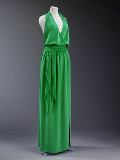 Halston (1975)   Halston was a popular designer during the 1970s, who developed a major drug problem and over licensed his brand. His styles were simple, comfortable, and easy to wear. The Halston dress pictured has a halter neckline and the popular maxi dress length of the 1970s.