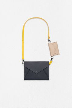 Leather envelope bags for urban nomads by Aiste Nesterovaite
