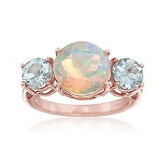 Poised at the center, a luminescent opal displays its natural flecks of colors. Sided by two aquamarines, 1.00 ct. t.w., the ring is quite the showstopper. 14kt rose gold over sterling silver ring. Free shipping & easy 30-day returns. Fabulous jewelry. Great prices. Since 1952.