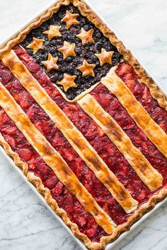 American Flag Pie Recipe ~ A sheet-pan slab pie with a homemade crust and a blueberry and strawberry filling, topped with stars and stripes. 4th Of July Desserts, Fourth Of July Food, July 4th, Fourth Of July Recipes, Memorial Day Desserts, Patriotic Desserts, Patriotic Crafts, Patriotic Party, July Crafts
