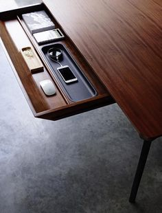 A sleek, wooden dining table that doubles as a desk with hidden drawer for storage. Click through for more photographs of multipurpose tables.