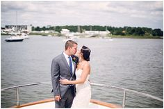 For this yacht wedding, the groom wore our French Kiss tie and pocket square in Navy. Ties ($19) and pocket squares ($10) at www.TheTieBar.com | Photo Credit: Red Boat Photography