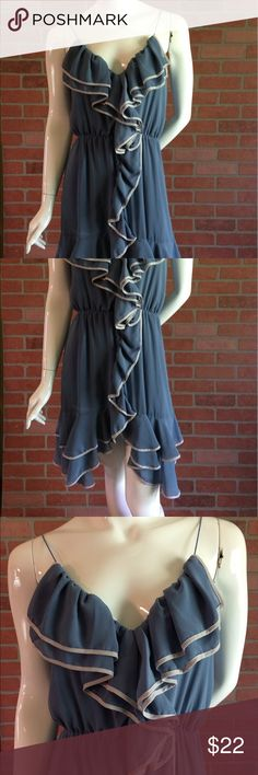 High Low Spring Summer  Sundress Spaghetti Strap Cute spring summer Sundress. Excellent condition. Size small. Pulls on over the head, doesn't Button or zip. Has large ruffles at the chest and down the front. Blue and cream. High law dress. 60% Silk 40% polyester lining 100% polyester. Fully lined. Light and flowy. Ya Los Angeles Dresses High Low