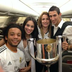 Marcelo with his wife Clarice and Di María with his wife Jorgelina celebrating on the plane. Copa del Rey 2014.