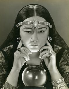 Female fortune teller with a crystal ball. photograph by Froelich, Russell,  1930s. Missouri History Museum Photographs and Prints Collections. Froelich, Russell Collection. n33296.