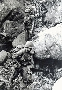 "The forward observer of Charlie Company, 4th Bn 12th Inf, 199th Light Infantry Brigade, 1LT Joseph T. Turner leads the way through rocky ground in the jungles 30 miles northeast of Xuan Loc. The Charlie company ""Warriors"" were on a sweep operation of the area, which contained many enemy bunkers. April 1970"