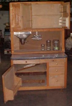 Hoosier Cabinet with flour sifter, space for cooking goodies.