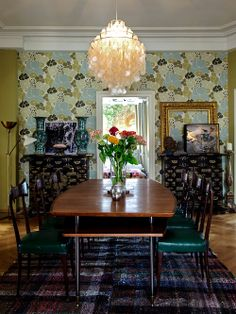 Beautiful dining room! Chandelier, vintage table, wallpaper Peace - that was the other name for home.