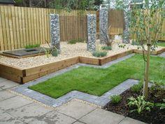 jardin avec gabionnage décoratif, gazon et jeunes arbres