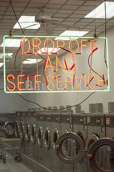 """Laundromat interior and neon sign"" - Laundry room decor available at Barewalls.com"