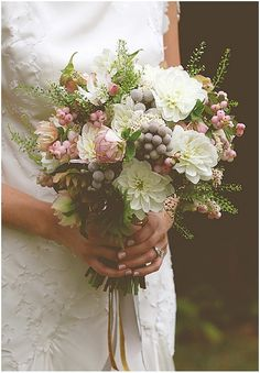 Soft and romantic, muted yet alive, this bouquet exudes a classic vintage style from every petal. This heady mix of dahlia, brunia, thlaspi, hellebore and snowberry is perfect for a late Autumn/early Winter wedding.