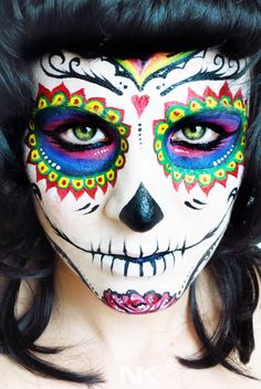 Sugar Skull Face paint tutorial. Dia de los muertos (Day of the Dead) --- I don't normally like Sugar Skulls but this one is really pretty and has more of an elegant factor. This video is cool to watch too it's more time lapse than tutorial. Who knows maybe I'll wear one, one day. X)