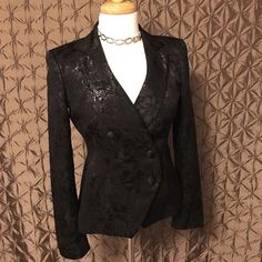 Body by Victoria Blazer Gorgeous black Body by Victoria blazer.  Flat black with shimmery black floral pattern.  Long sleeved with padded shoulders.  Cross over front with two button closure.  Has six cloth covered button, but only two are used to button up.  Great for New Years Party!! Victoria's Secret Jackets & Coats Blazers