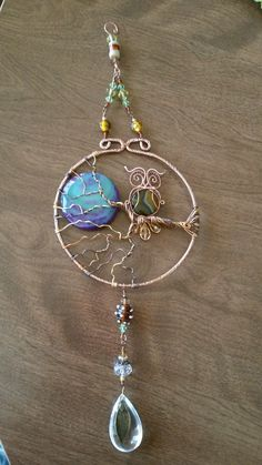Wire wrapped sun catcher with owl on a branch. Full moon, agate leaf pendant.