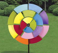 Crazy Spinner 1 Wood Pattern This large and crazy layered spinning project is just plain fun to watch!! This colorful design has three layers that spin independently in the wind with the middle layer spinning in the opposite direction. #diy #woodcraftpatterns