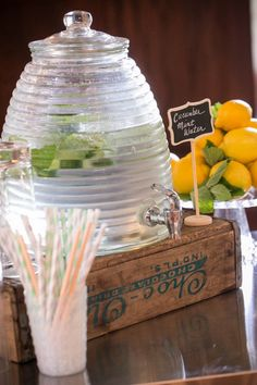 beverage station at event cucumber mint flavored water with colored straws rustic drink station at Willowdale Estate, Topsfield Massachusetts venue for weddings and events. willowdaleestate.com