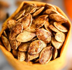 Homemade Roasted Cinnamon Sugar Pumpkin Seeds Recipe! Don't throw away the seeds when you carve pumpkins this year! Save them and make this recipe for the perfect sweet and salty fall snack! Vegan, gluten-free and dairy-free! and paleo-friendly! #pumpkin #pumpkinseeds #homemade #healthy #recipe #glutenfree #dairyfree #vegan #cinnamonsugar #paleo Cinnamon Sugar Pumpkin Seeds, Pumpkin Seed Recipes, Nut Recipes, Sweets Recipes, Snack Recipes, Cooking Recipes, Healthy Recipes, Fall Recipes, Holiday Recipes