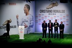 President of Real Madrid CF Florentino Perez (R) poses for the media with his player Cristiano Ronaldo (2nd R) holding the Golden Boot award close to manager of Marca newspaper Oscar Campillo (2nd L) and Cees van Cuilenborg form the Eropean Sports Media (ESM) at Melia Castilla hotel on November 5, 2014 in Madrid, Spain. Cristiano Ronaldo's 31 strikes in La Liga last season have given him his third Golden Boot award.
