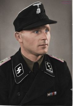 Portrait of a Panzer SS Obersturmführer. The last ribbon on his chest is a Slovakian Medal for Bravery. Shoulders cyphers unknow. Enjoy the colourisation !
