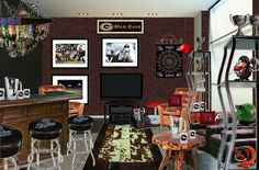 How do you solve a man cave that is too personalized to sell your home? I'm one of 10 blogger's in @Cheryl Brogan 's January #Oliohop! Take a look at my Man Cave - Before & After for the 'Staging your Home for Sale'. See how I 'makeover' a man cave and make it an inviting media room! :) - Here's the Before .......    http://stagetecture.com/2013/01/january-oliohop-staging-a-home-for-sale-before-after/