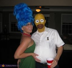 Marge & Homer :) OMGSH @Shaun Harpstrite, @Pat Williams, I remember when Cameo wore her hair that high or higher as Marge and drove us to a halloween party!!  I remember seeing her push it into the ceiling of the car as she got in!  What a riot!