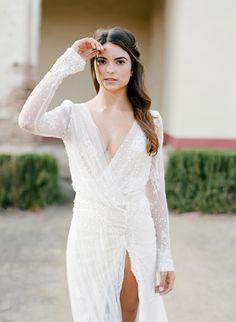 Beaded long sleeve wrap wedding dress: http://www.stylemepretty.com/2016/07/19/stylish-california-elopement-inspiration/ Photography: Jose Villa - http://josevilla.com/