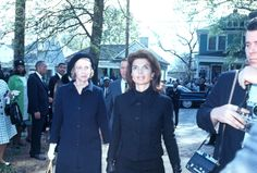 Jacqueline Bouvier Kennedy and Companion Walking in Street  as Mrs. John F. Kennedy leaves the home of Mrs. Martin Luther King, Jr., after paying her respects to the widow of the slain Civil Rights leader.  Date Photographed:April 09, 1968.