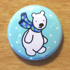 http://www.etsy.com/es/listing/65707410/winter-polar-bear-with-scarf-badge?ref=shop_home_active