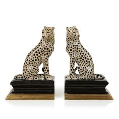 Bring a sense of safari to your book shelf or mantle with this stunning set of porcelain cheetah bookends featuring two striking cheetah cats sitting ...