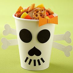 Quick Spooky Snack    Ready in no-time, this three-ingredient snack mix can be scooped into treat bags or left in a bowl for hungry trick-or-treaters to serve themselves.