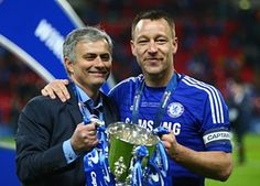 Posing with the League Cup with José Mourinho after beating Tottenham in the Capital One Cup final 1 March 2015