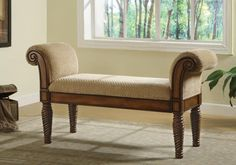 Bench CS100224 Description:  That stately upholstered bench will make a statement in your entryway, hallway, bedroom or living room. A beautifully detailed wood base is accented with turned post legs and curved armrests with detailed carvings. A cushioned seat is upholstered in a neutral fabric that continues on the rolled arms for plush comfort. Use this upholstered bench with arms anywhere you need additional seating and a hint of traditional style.  Features:-  Wood & Finish : Medium…