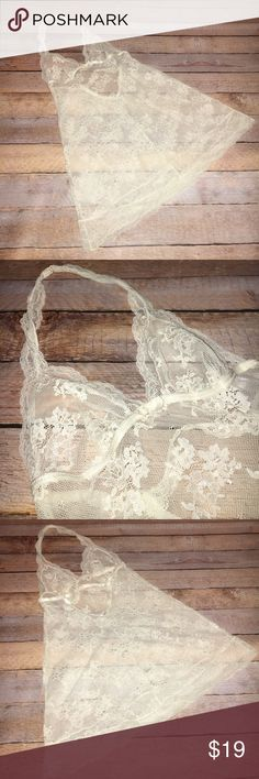 "NWOT VS Ivory Halter style Babydoll ✔️NWOT VS Ivory Halter style Babydoll ✔️Ivory lace body with lace halter top that closes with a hook at back of neck  ✔️Elasticized bustline/back ✔️Size S ✔️One hook closure at back ✔️Bust 13"" across unstretched, 19"" stretched ✔️Length from under bust to hem 16.5 Victoria's Secret Intimates & Sleepwear Chemises & Slips"