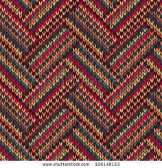 Knit woolen seamless jacquard ornament texture. Fabric color tracery background by Essl, via Shutterstock