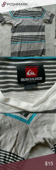 "Men's quicksilver striped shirt Used, with some pitting under the arm pits.  Not too noticeable, but they are there.  No other issues.  Loved this shirt, wish I want selling it!  Although a Medium, fits like a large (I'm 6 2"") Quiksilver Shirts Tees - Short Sleeve"