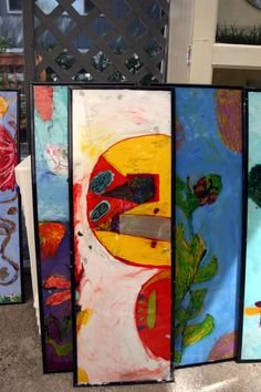 some of the kid's artwork- reverse glass painting