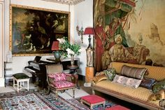 Decorated by Robert for the Prince of Wales, the Garden Room of Clarence House has a sofa covered in a colourful antique fabric; the piano was often used by Noel Coward when he visited the Queen Mother.