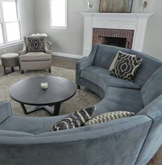 This curved blue couch is FANTASTIC.  where do you find this????