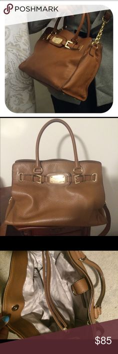 MK Purse Soft tan leather. With gold hardware. Two inside zippers. Four pockets to hold cellphone ect. No marks other than on the handles (see pic). Inside is very clean with no stains or marks. Michael Kors Bags Shoulder Bags