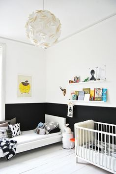 The great divide: Chalkboard paint makes for a creative wainscot! As baby grows, so will his imagination! #nursery #diy #chalkboard