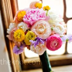 This bouquet it perfect!  the yellows make it a little less feminine and the wildness definitely portrays the theme I want for my wedding.