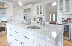 Granite countertop color Bianco Romano on this kitchen island looks like Carrara marble. I love this!!