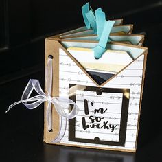 Easy DIY Tag Mini Album - This was made with my Silhouette Cameo. It's super cute and makes a great gift.