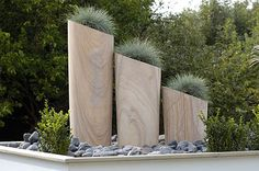 Found these amazing planters in www.designandlandscape.co.uk At £350 ...