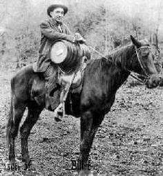 James Bailey of Knox County, Kentucky, holds a barrel of moonshine, ca. 1920.  Found this photo on kentuckyexplorer.com